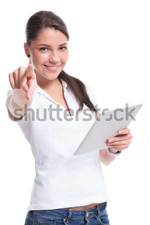 casual woman with pad pointing Stock photo © feedough