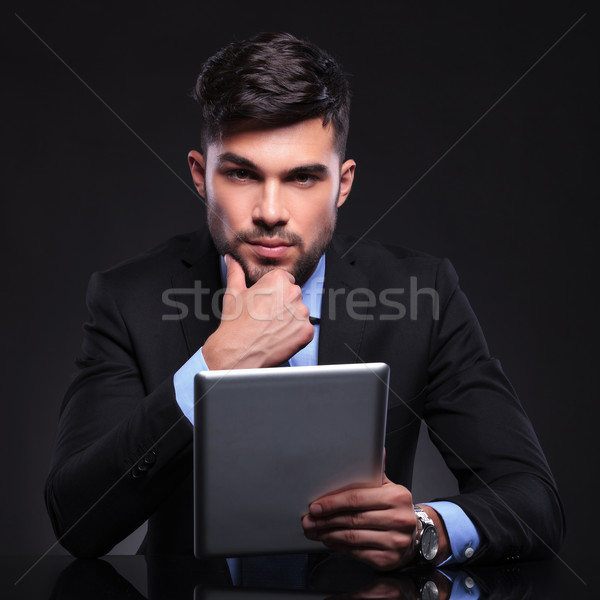 pensive young business man with tablet Stock photo © feedough