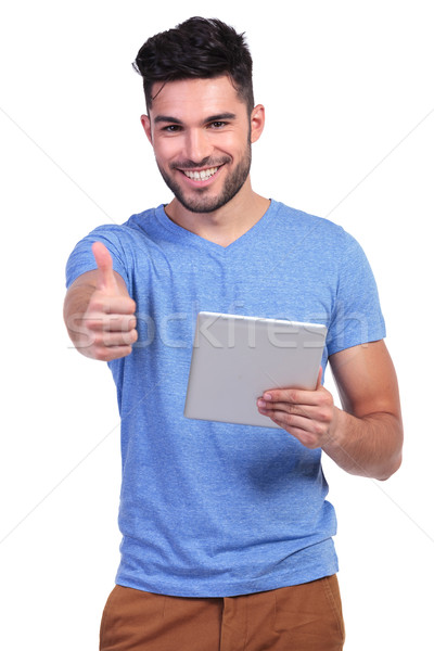casual man reading good news on his tablet pad  Stock photo © feedough