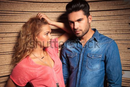 young casual couple with hands on jackets Stock photo © feedough