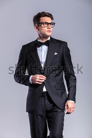 handsome business man holding his hands in pocket  Stock photo © feedough