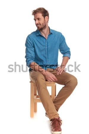 full body picture of a seated casual man Stock photo © feedough