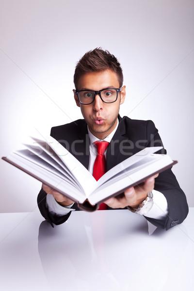 Człowiek książki człowiek biznesu wyimaginowany górę Zdjęcia stock © feedough