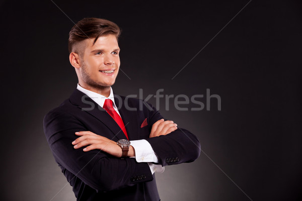 Stock photo: young business man with arms crossed