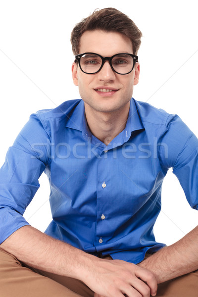 Smiling young fashion man sitting with his legs crossed Stock photo © feedough