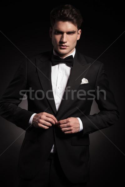 Elegant handsome man closing his jacket Stock photo © feedough