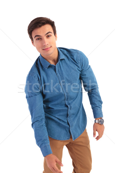 casual man is fooling around with a pose Stock photo © feedough