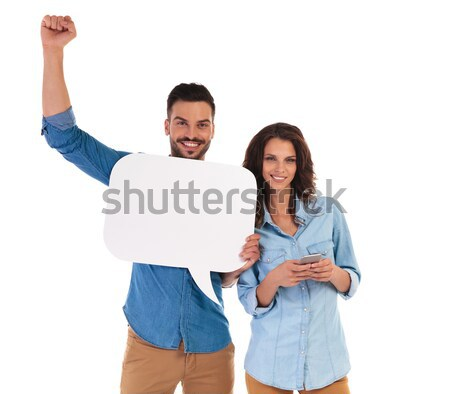 man holding speech bubble looks at woman  texting on phone Stock photo © feedough