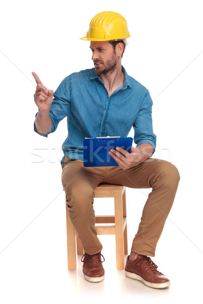 displeased construction engineer pointing finger to side Stock photo © feedough
