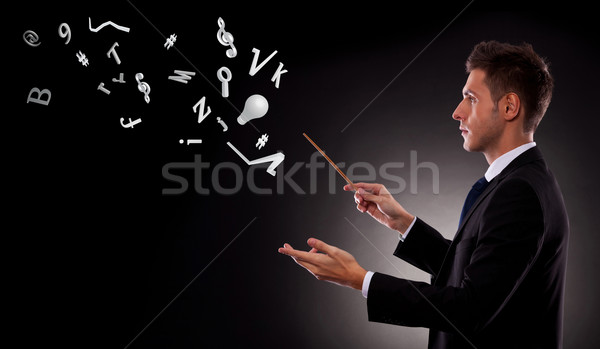 business man directing lots of symbols Stock photo © feedough
