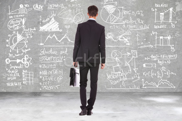 business man with briefcase looking at calculations Stock photo © feedough