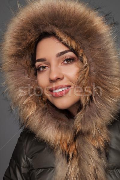 smiling young woman wearing furry hood  Stock photo © feedough