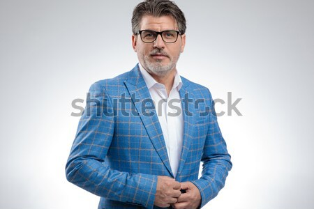 portrait of confident smart casual man with arms folded Stock photo © feedough