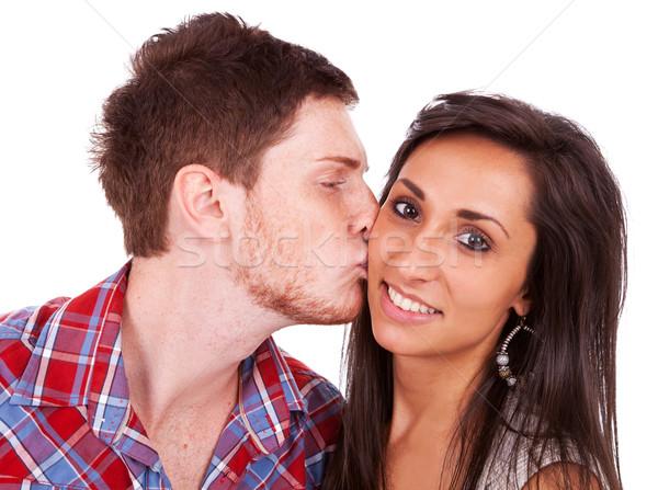 Jonge man zoenen vriendin wang vrouw Stockfoto © feedough