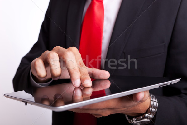 business man tapping and browsing on pad Stock photo © feedough