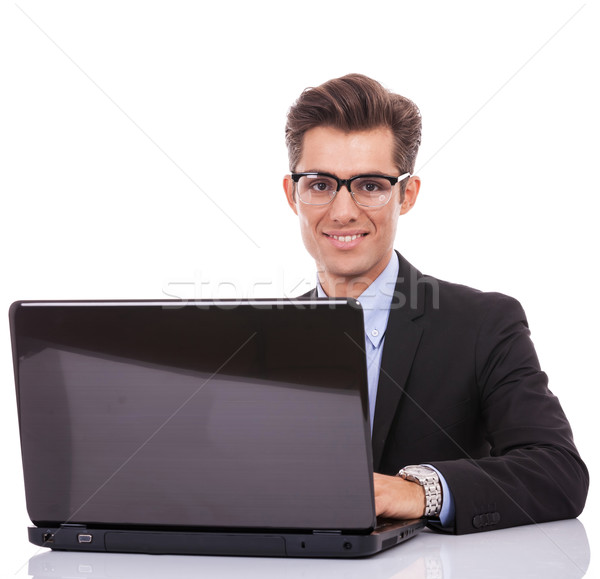 Stock photo: Business man at his desk with a laptop