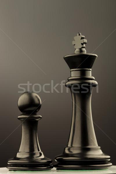 Zwarte koning pion schaken studio foto Stockfoto © feedough