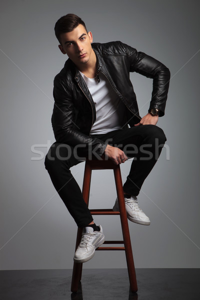 male model in leather jacket posing seated while resting  Stock photo © feedough