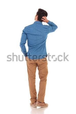 back view of a pensive man scratching his head  Stock photo © feedough