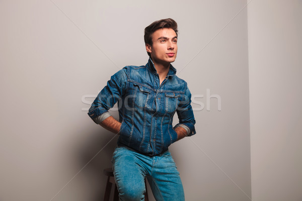 seated man in jeans jacket dreaming away Stock photo © feedough