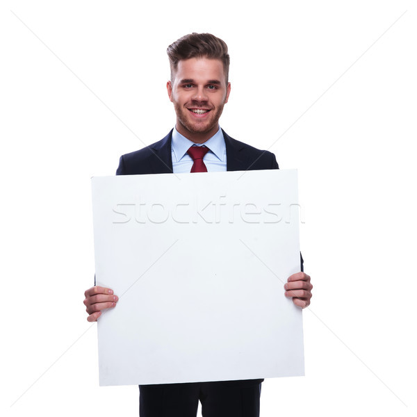young unshaved businessman holds an empty billboard Stock photo © feedough