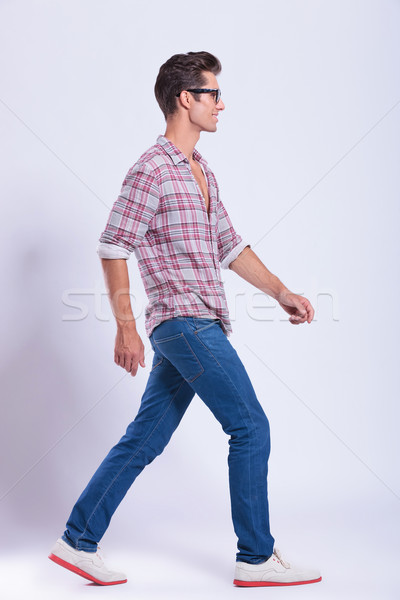casual man walks in front of you Stock photo © feedough