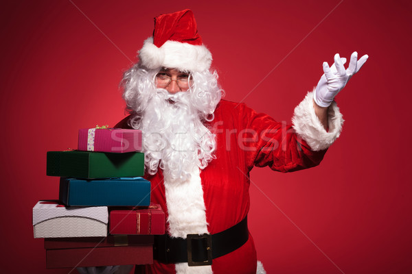 santa claus is inviting you to get some presents  Stock photo © feedough