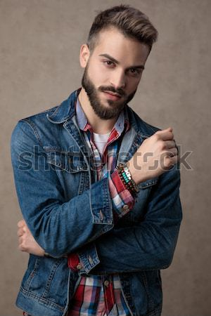 casual fashion man pulling his leather jacket  Stock photo © feedough