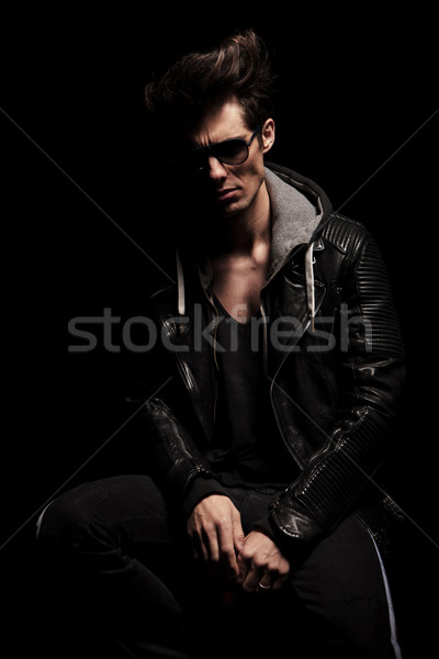 dramatic man in leather clothes with weird hairstyle Stock photo © feedough