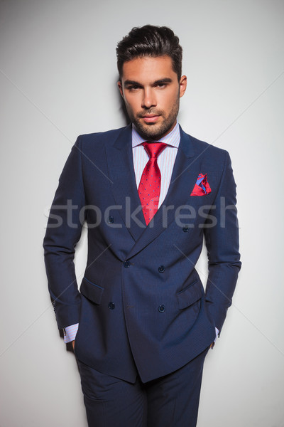 relaxed man in double breasted suit  with hands in pockets  Stock photo © feedough