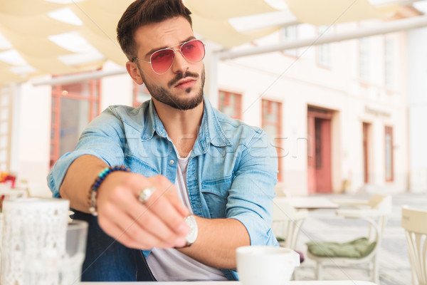 casual man having coffee in the city looks to side Stock photo © feedough