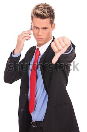 Człowiek biznesu bad news komórka negatywne odpowiedź biuro Zdjęcia stock © feedough