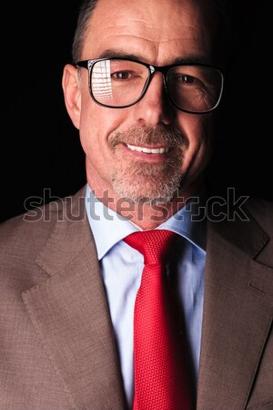 happy old business man unbuttoning his coat  Stock photo © feedough
