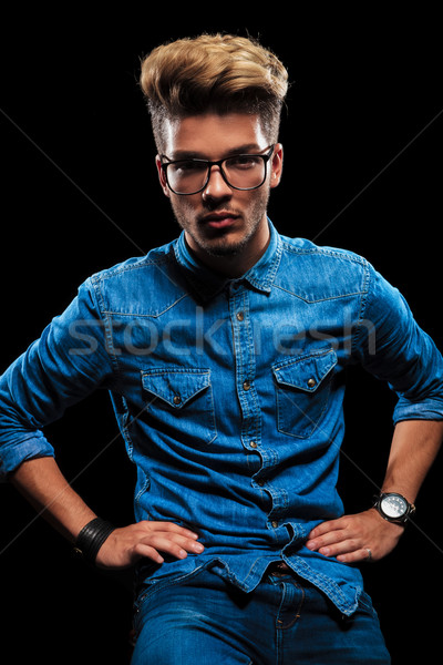 male model posing wearing jeans, denim shirt and glasses Stock photo © feedough