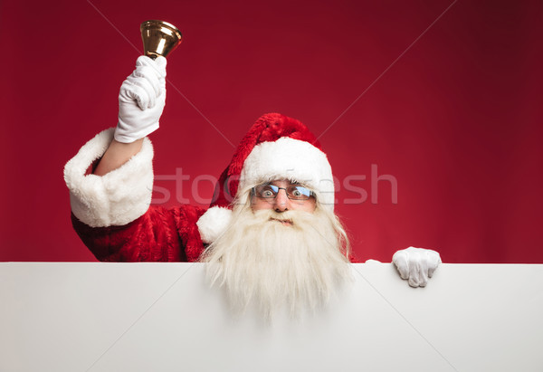 santa claus on top of a blank board ringing  bell  Stock photo © feedough