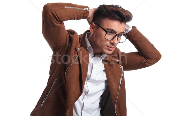 side view of a casual man with hands behind neck  Stock photo © feedough