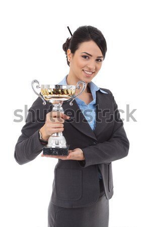 young business woman holding a trophy Stock photo © feedough
