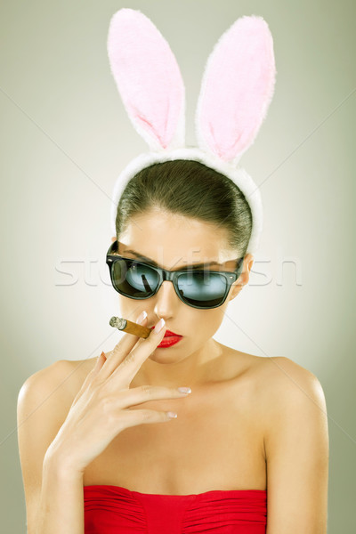 bunny woman  smoking on a big cigar Stock photo © feedough