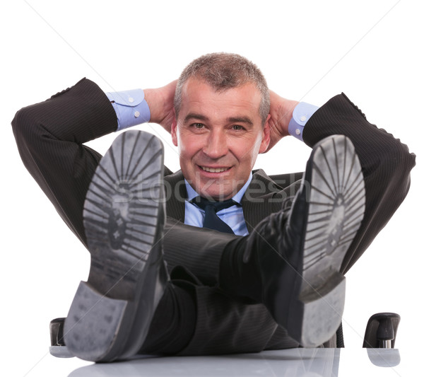 business man with feet on desk smiles at you Stock photo © feedough