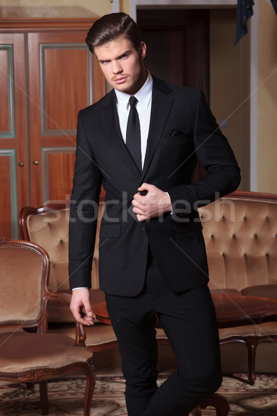 young business man unbuttons suit Stock photo © feedough