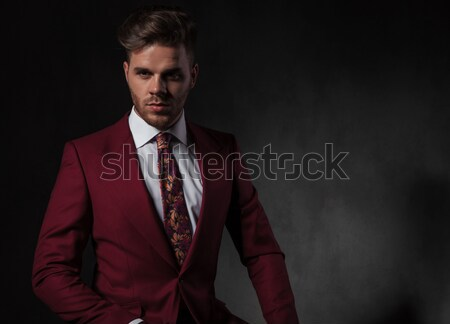 portrait of young man looking down arranging his jacket Stock photo © feedough