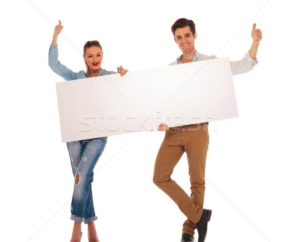 attractive couple posing with legs crossed Stock photo © feedough