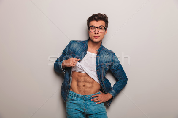cool young man showing his abs  Stock photo © feedough