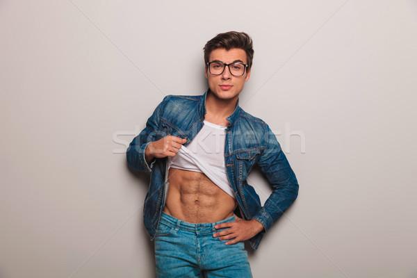 Cool junger Mann grau Wand Stock foto © feedough