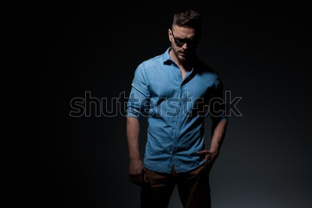 portrait of unshaved man in leather jacket leaning on wall Stock photo © feedough