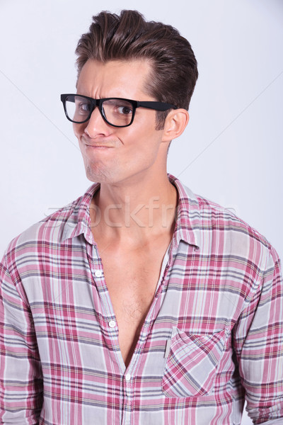 casual man looks with doubt Stock photo © feedough