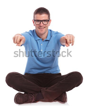 seated casual man points with both fingers at you Stock photo © feedough