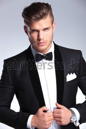 imposing fashion man in tuxedo snapping his fingers Stock photo © feedough