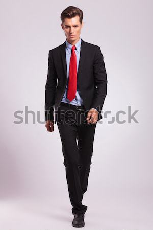handsome business man leaning on a white table  Stock photo © feedough