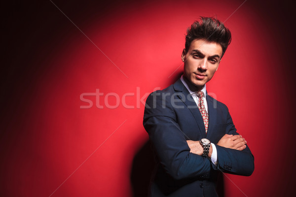 frowning businessman with red tie and hands crossed  Stock photo © feedough